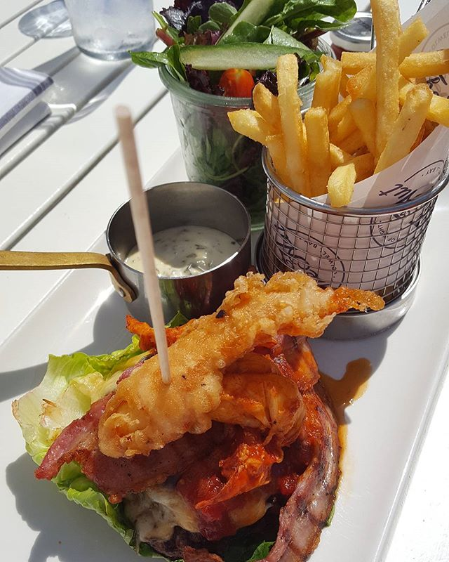 When you can't resist a lobster, burger and chips treat on the weekend  This is the yummiest beef burger patty weekend treat I reduced the carbs by going wheat-free no bun With bacon, cheese and salad And a lobster claw in tempura batter  Lobster meat And chips  @thehutcolwell