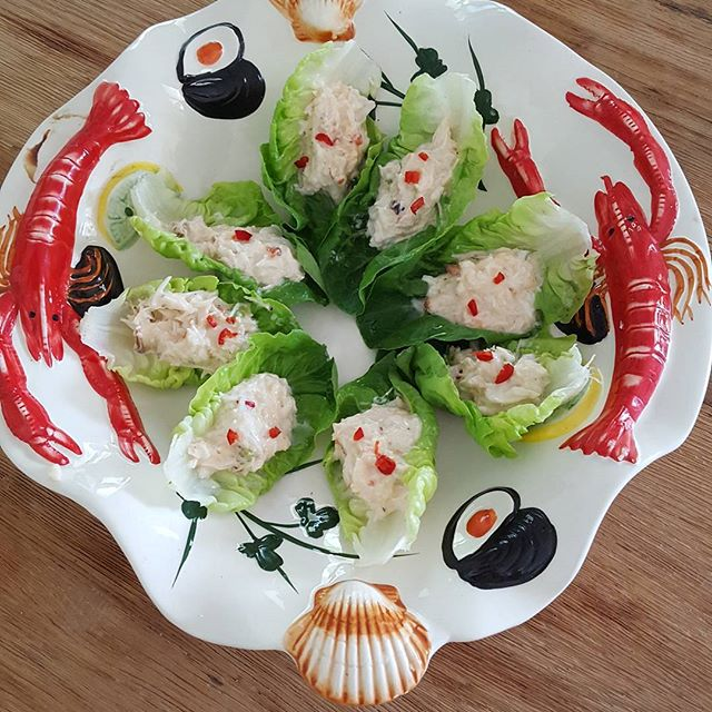 Crab in lettuce shells   Crab mixed with creme fraiche,chopped chilli, spring onion, salt and pepper  In lettuce shells.