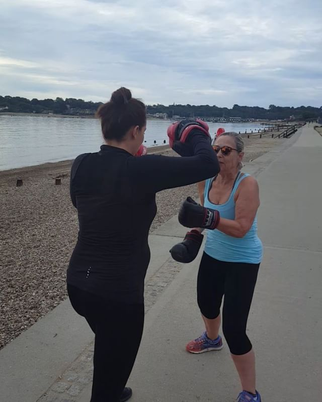 When boxing with a very pregnant personal trainer it's important to keep focused!  Early morning training on the beach. Boxing is great for core strength, stamina, arms, upperbodyworkout.  sixtyplus