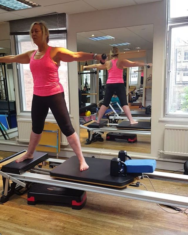 Back in the pilates studio  This exercise engages core, helps spinal mobility, hip flexors, balance, gluteals and flexibility. It is much harder than it looks as it also requires the reformer to be held out and stay in place and still whilst bending over and twisting