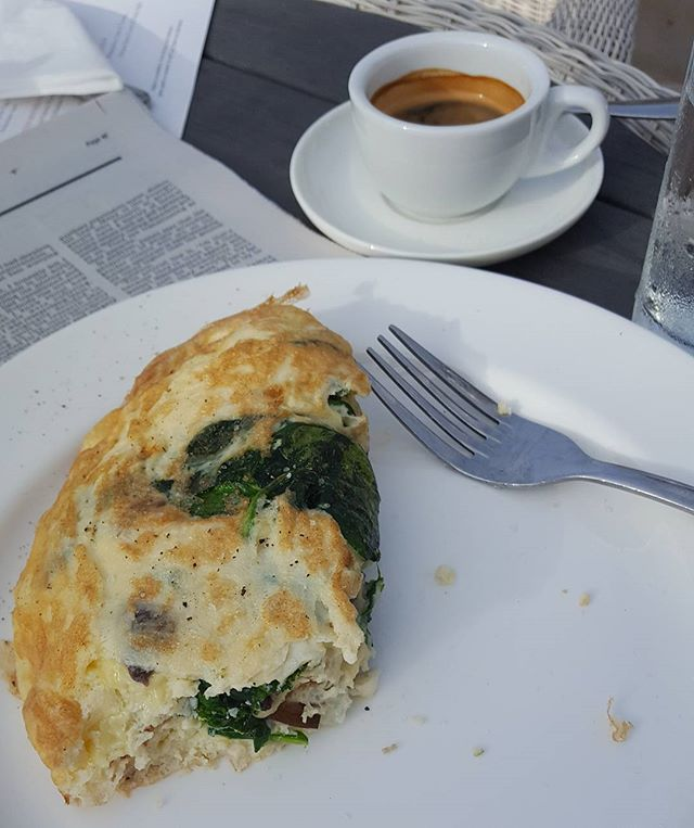 Healthy low carb and protein breakfast post-exercise workout  Omelette with cheese, spinach and mushroom and an expresso coffee.