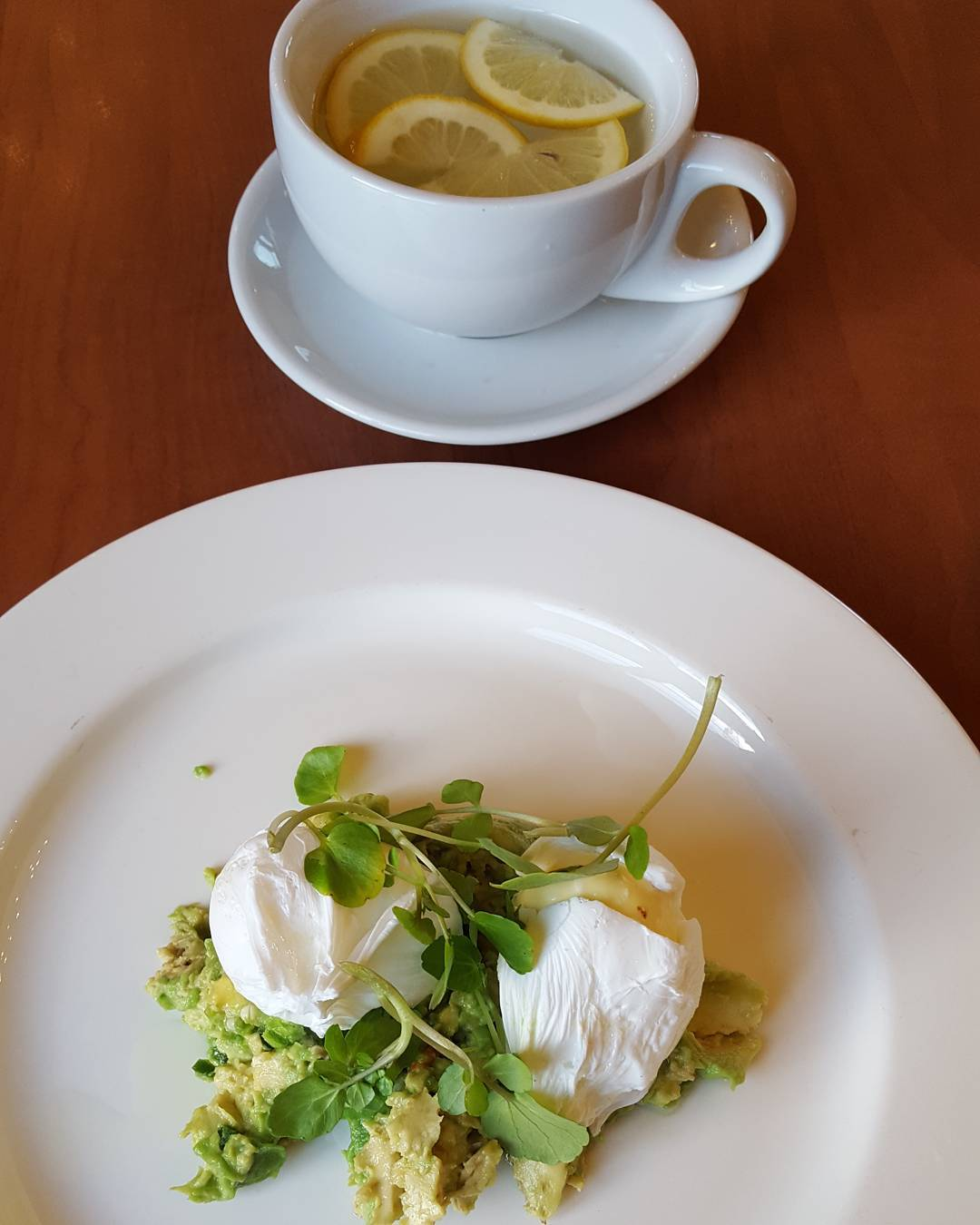Protein, low carb and good fats healthy breakfast post workout.  Poached eggs on smashed avocado with chopped chillies .