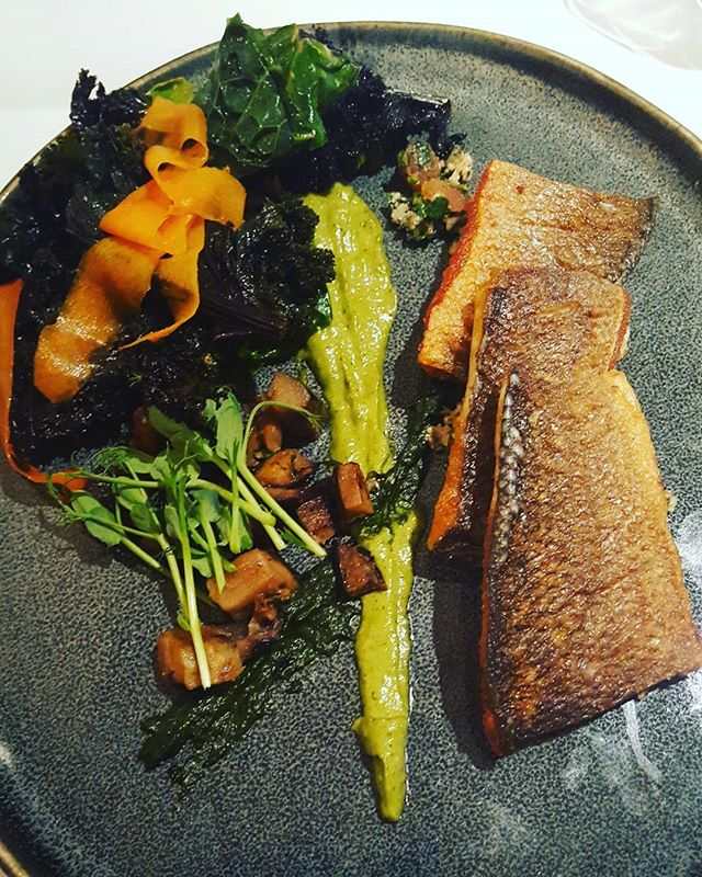 Fillet of Seabass with cavolo nero , cauliflower tabouleh, and aubergine caponata and mixed vegetables.  Healthy good fats in the seabass with crispy skin -yum!  A smear of aubergine puree and cauilflower couscous and crispy cavolo nero. The carrot is sliced and cooked together with cabbage and kale. Mixed together with some Moroccan style spices.  vegetables