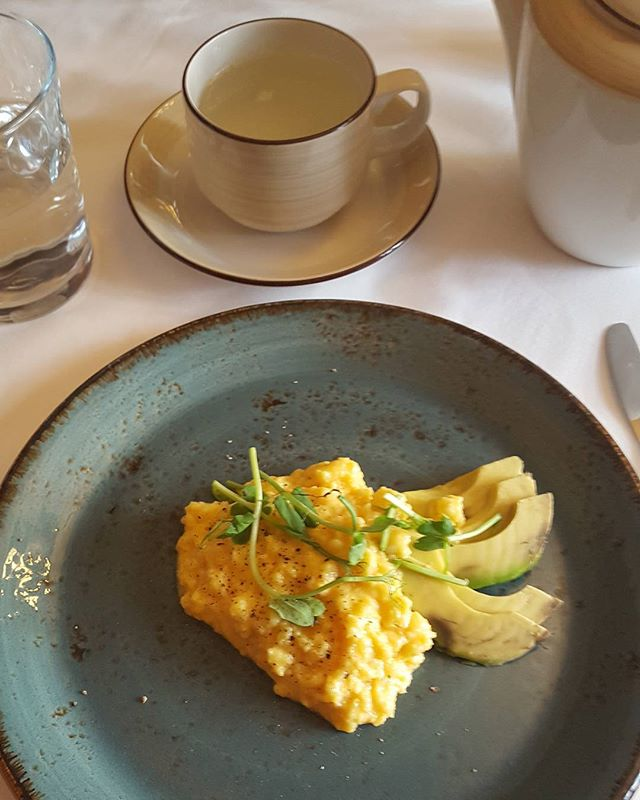 Sunday breakfast.  Scrambled eggs and avocado with some shoots and lemon and ginger hot water. Protein in the eggs and complex carbs and good fats in the avocado.  @grayshottspa