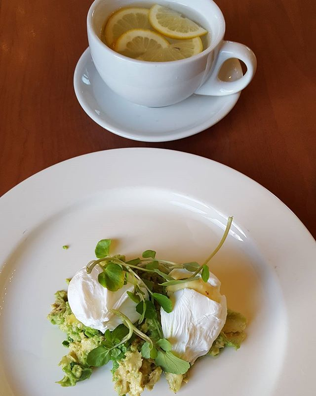 A simple healthy breakfast for your best start to the day.  Lemon and ginger water. Poached eggs on smashed avocado for protein and good fats.