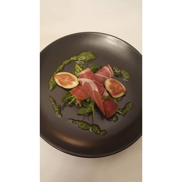 Even the simplest of food looks more appetizing when presented prettily on the plate.  Portion control is important when making how you eat a lifestyle choice not a diet.  A smaller portion styled attractively on a small plate will make you feel you've still eaten well and satisfied.  Parma ham with fresh figs and green pesto ( basil, pine nuts, garlic and olive oil)  dressing and salad leaves.