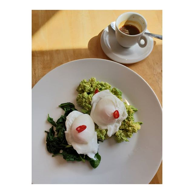 My wheat free low carb and protein breakfast.  The chef in the cafe who cooked breakfast this morning was obviously feeling creative with the chillies. 2 poached eggs on crushed avocado with chillies and wilted spinach. No toast and an espresso.