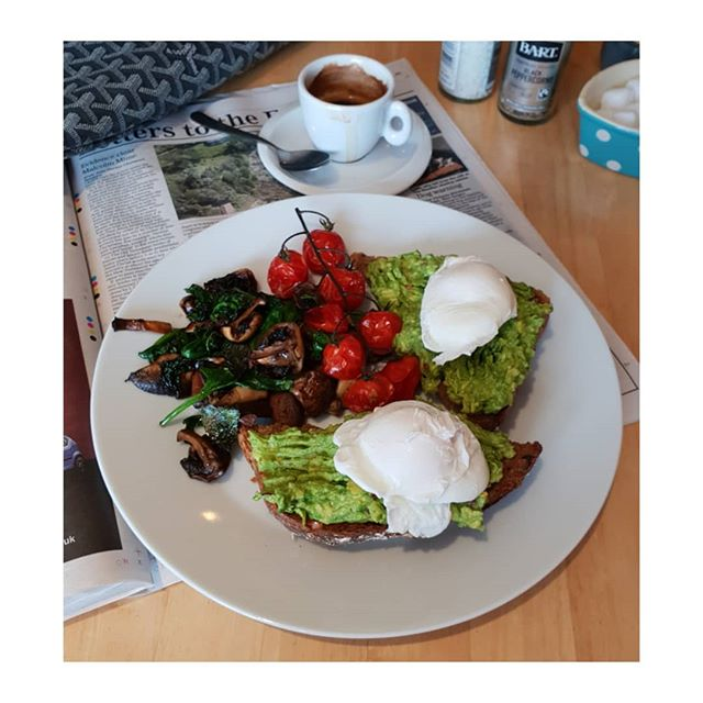 A healthy breakfast worth waiting for.  After a 12 hour overnight fast for a healthy gut. After a 16/18 hour overnight fast to lose weight. After exercise. Tomatoes, wilted spinach, mushrooms, poached eggs on sourdough toast with avocado and chillies and an espresso coffee. A yummy breakfast of protein, low carb and good fats. . . . .. .