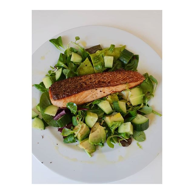 A quick healthy Summer lunch inspo.  Organic salmon fillet shallow-fried in organic butter so that the skin goes crispy (start flesh side down) will only take 5 minutes to cook. On a bed of leaves with avocado and cucumber. Eating at least 3 portions of oily fish gives you Omega3 fatty acids essential for a healthy brain, heart and eyes. . . . . .