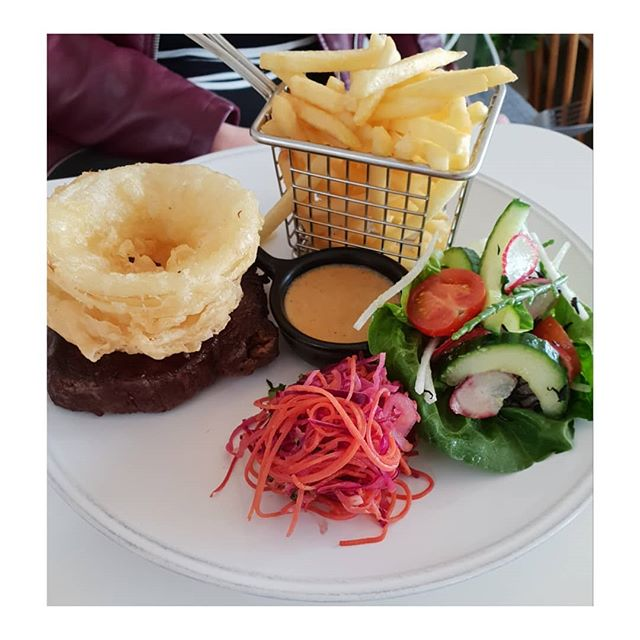 Isle of Wight steak, onion rings, miso pepper sauce, fries and Asian slaw.  When you're out to dinner and your friend orders the very yummy less healthy carb heavy option. . . . . . @smokinglobster1