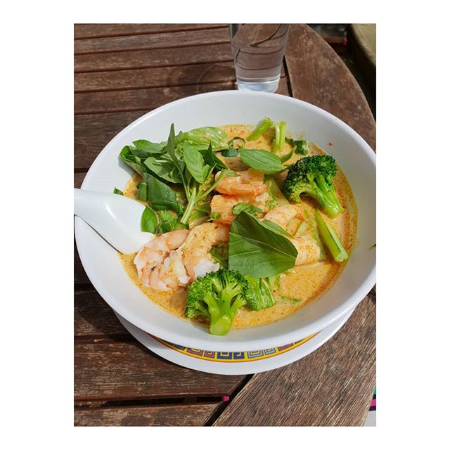 Thai king prawn Laksa curry lunch in the sun today at Phat Phuk noodle bar London.  Low carb and protein Thai lunch on London's Kings road Chelsea. My favourite little cafe with Thai street food. Yummy healthy and inexpensive. I always ask the rice noodles to be replaced with vegetables so they add extra broccoli and leaves.  The base ingredient of a Laksa is coconut milk which has loads of health benefits:  Improves Heart Health by Lowering Blood Pressure and Cholesterol.. Builds Muscle and Helps Lose Fat. . Provides Electrolytes and Prevents Fatigue. ... Helps Lose Weight. ... Improves Digestion and Relieves Constipation. ... Manages Blood Sugar and Controls Diabetes. ... Helps Prevent Anemia. . . . .