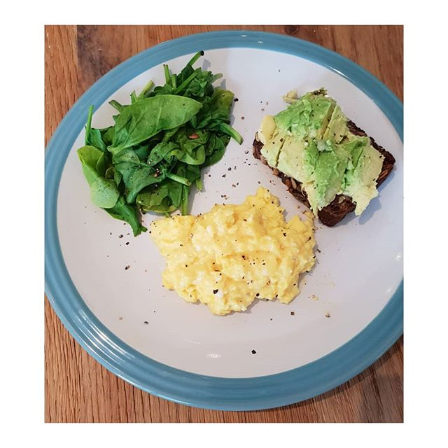 Healthy low carb and protein post workout breakfast.  Scrambled eggs with organic butter, wilted spinach, and smashed avocado on seeded multigrain  toast. A nutritious breakfast to keep you feeling fuller longer with less blood sugar highs and lows.  12 hours since last meal and this 1st meal of the day to help digestion. I start the day with warm lemon water and then a small swig of Kefir with a liquid multi-vitamin mixed in with it.  All fermented foods help to promote good gut health. . . . . .