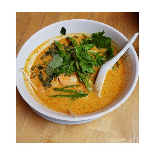 When you're feeling chilly, this spicy Thai prawn laksa does a great job of warming from inside out. . . . A coconut milk soup with Thai spices, chilli and lemongrass with rice noodles, giant prawns,basil, beans, beanshoots, broccoli, greens Healthy, low carb and protein. Filling and yummy. . . . .  #@phat_phuc_noodle_bar