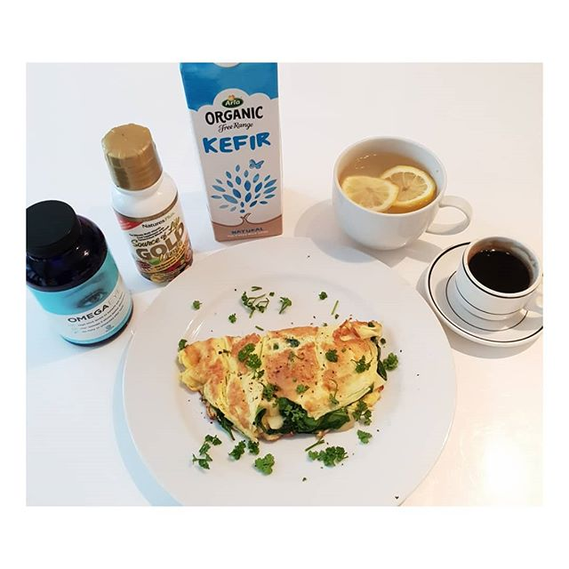 My healthy breakfast and supplements today. . Hot water and lemon to start the day. . Kefir with Source of Life Gold Liquid multivitamin. Kefir for gut health . OMEGA EYE omega 3 especially for eye health . Single Expresso . 2 organic egg omelette for protein intake with raw cows milk Gruyere ( for good gut health- not in you're pregnant) and spinach for additional iron, vitamins and good carbs. . . . . .