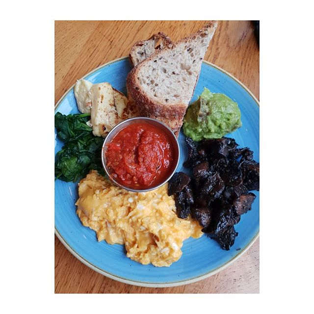 Only intended to have just an Expresso coffee after my Pilates class..... . . However I ended up with a veggie brunch! . . Scrambled eggs, wilted spinach, mushrooms, grilled halloumi cheese,  7-seeded sourdough toast, spicy chilli tomato relish, smashed avocado. . . . . .