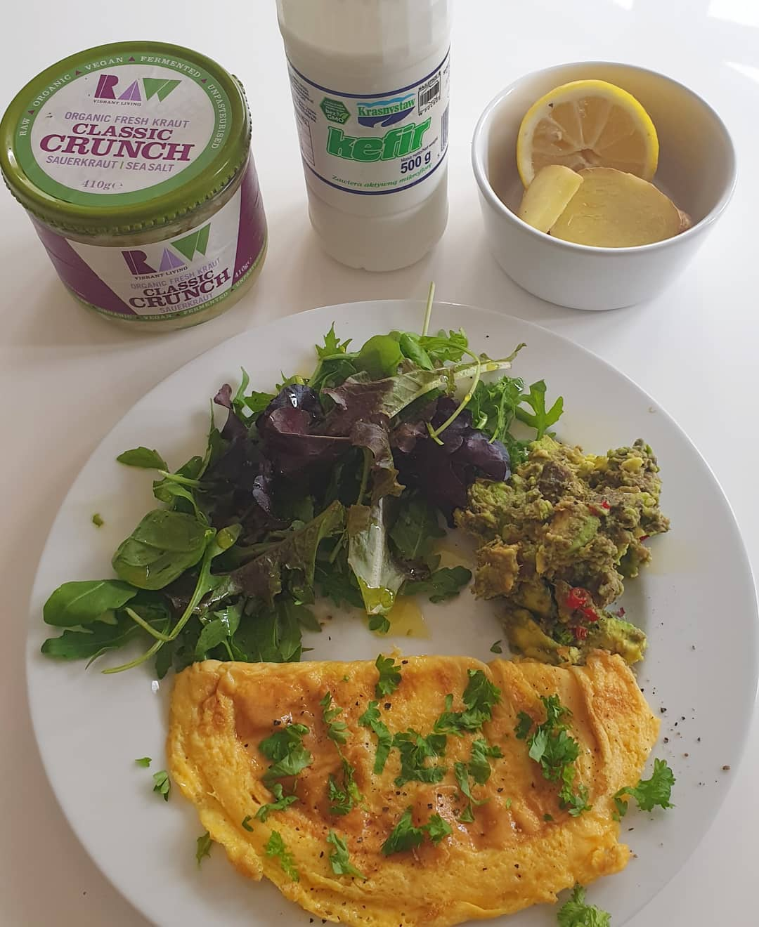 The beginning of a detox week. First meal of Monday, 16 hours since the last meal on Sunday evening. . Day started first thing with mug of hot water, lemon and ginger. . Expresso coffee mid-morning. . Sauerkraut and a small glass Kefir before the main meal of the day:  Organic 2 egg omelette, salad leaves, smashed avocado with chillies, and drizzle of olive oil and some chopped parsley. . Cup of 'white' not green, herbal tea at tea-time. . At around 6pm this evening's supper is a large cup of chicken and vegetable bone broth. . Then a 12 hour fast until Tuesday. . . . . .
